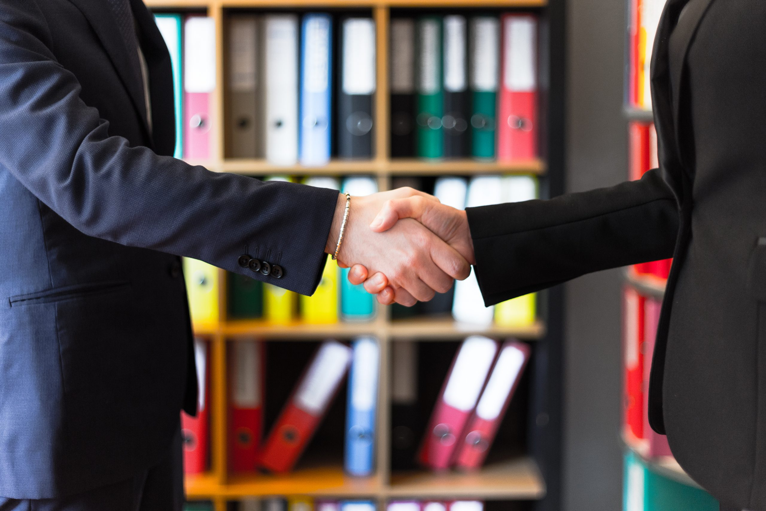 photo-of-two-people-shakehands-2058130-scaled
